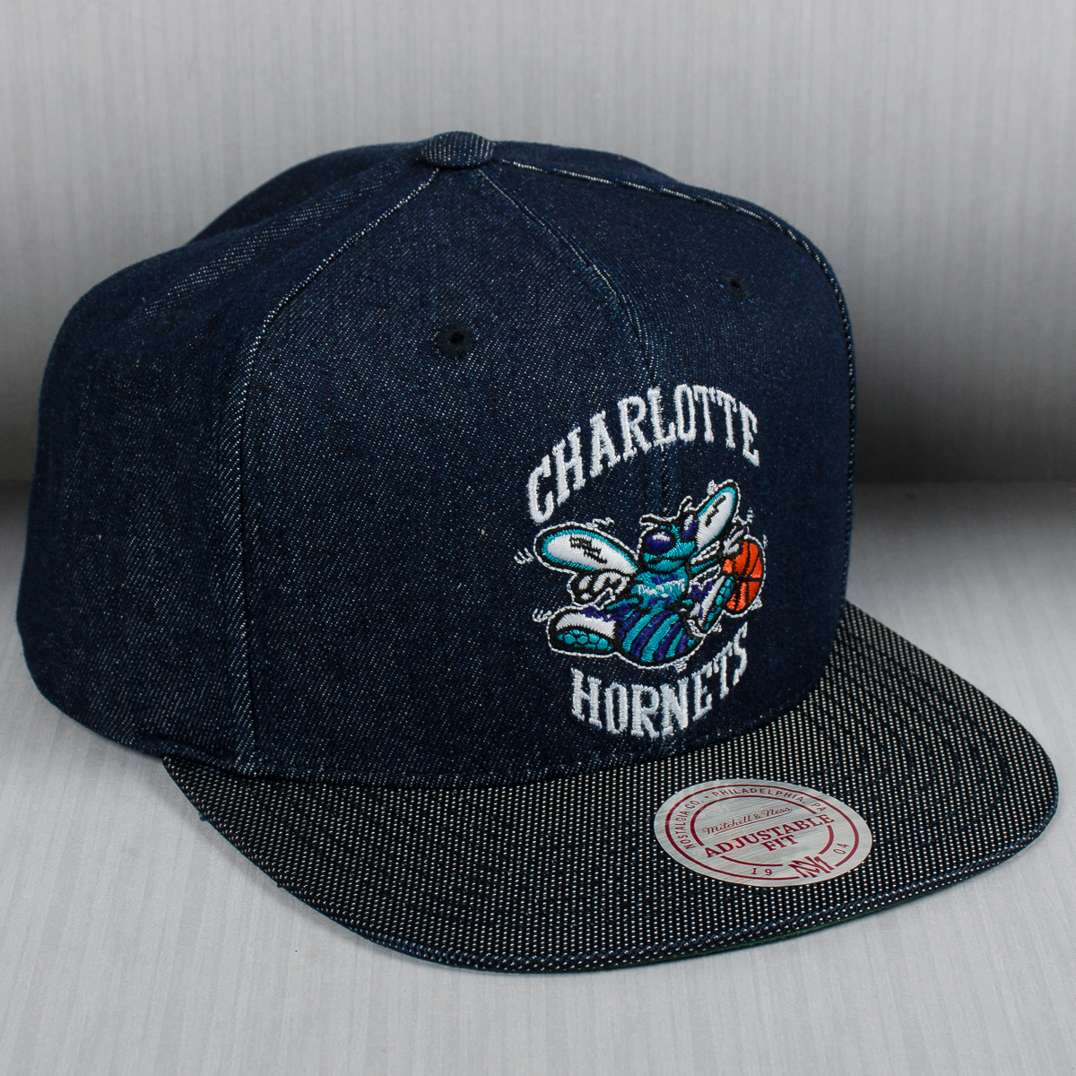 6168ee7f27550 ... where to buy mitchell ness nba charlotte hornets raw denim snapback cap  nba shop charlotte hornets
