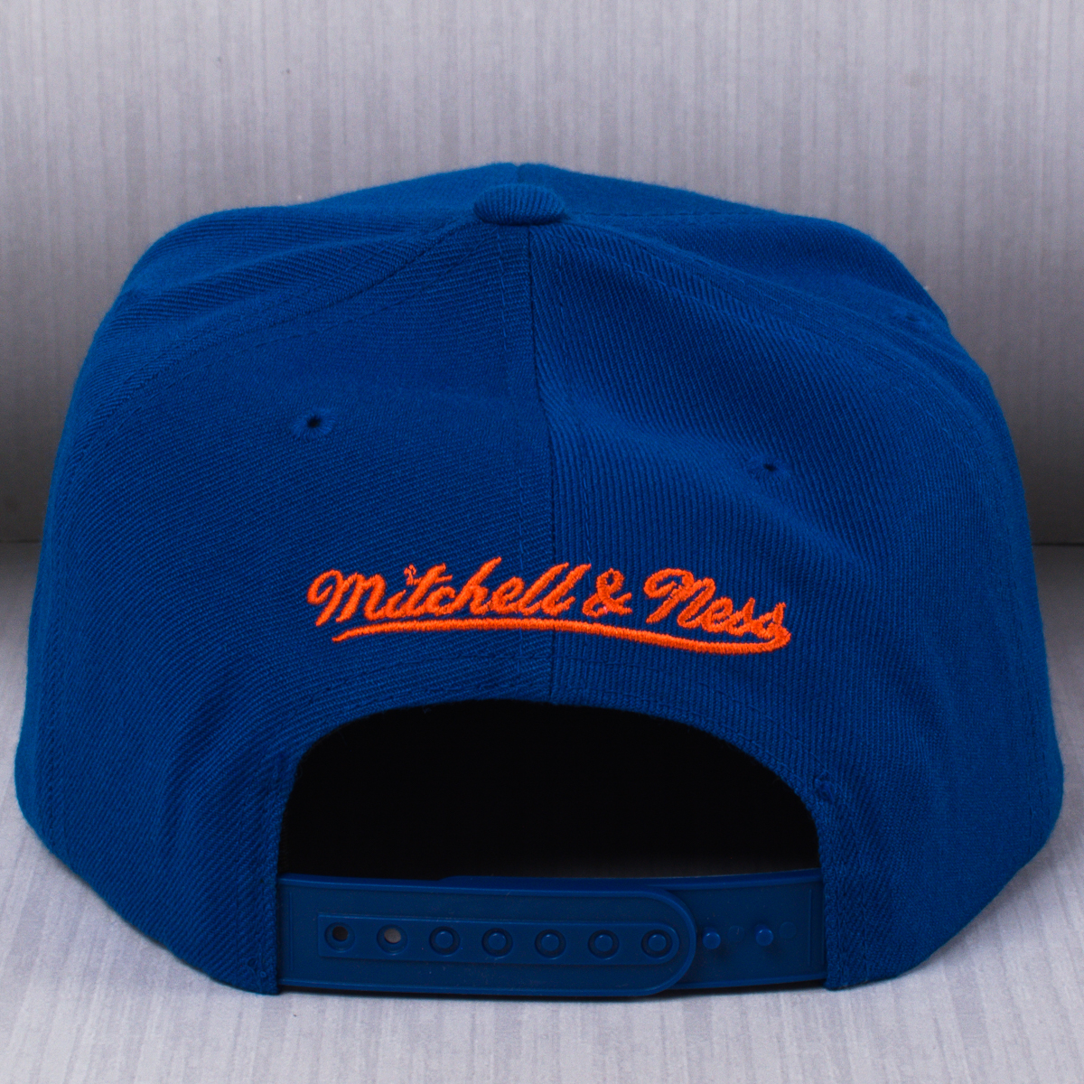 new styles 04628 daef1 Mitchell   Ness NBA New York Knicks Vice Script Solid Snapback Cap